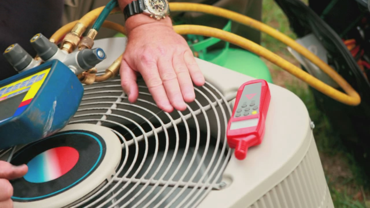 Air Conditioning Service Technician monitoring outdoor unit